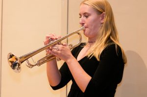 Why is playing the trumpet a male-dominated profession?